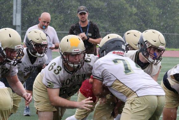 Clarkstown South football players practice  through the rain Aug. 13, 2018.