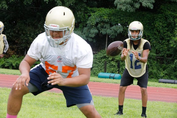 Members of the Yonkers Force high school football team practice drills at Lincoln High School in Yonkers on Aug. 13, 2018.