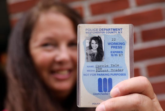 Photographer Carrie Yale holds a press pass from the eighties, Aug. 12, 2018 in Mount Kisco.