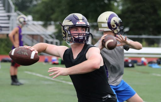 Clarkstown North quarterback Frank Ross passes during practice Aug. 13, 2018.