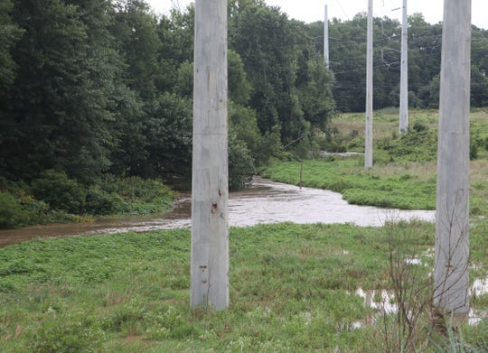 The Christina River passed its 11-foot flood stage around Cooch's Bridge Monday morning.