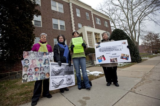 Judy Miller, Martha Conaty, and Joelle Casteix, all with SNAP (Survivors Network of those Abused by Priest), Sister Maureen Turlish, with Voice of the Faithful  protest outside of Catholic Diocese of Wilmington in 2011.