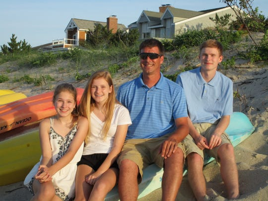 A July 2016 photo of Wilmington Fire Capt. Christopher Leach and his children: (left to right) Megan, 12, Abby, 13, Chris, 40, and Brendan, 16. (Ages are at time of photo.)