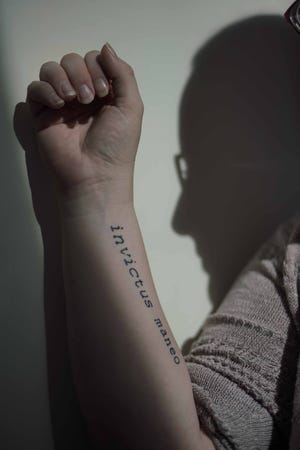 """Mary, whose identity is being concealed for personal reasons, had a tattoo with the Latin phrase """"I remain unconquered"""" on her arm to remind her of surviving the sexual assault from former priest John Sarro, who died six months before a scheduled trial in New Castle County Superior Court."""