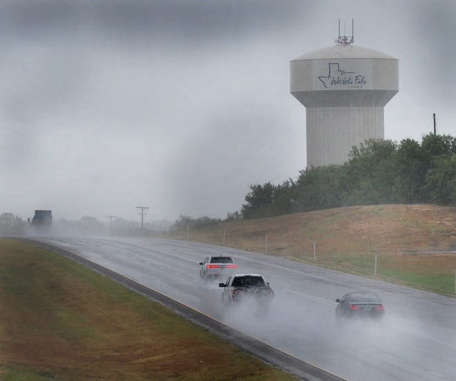 Traffic travels a rain-wet US 287, Monday morning as the city of Wichita Falls receives much-needed rain.