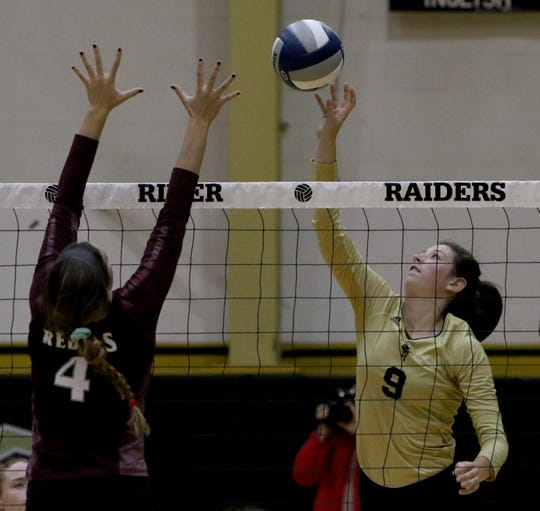 Rider's Maegan Lacy sends the ball over the reach of Midland Lee's McKenzie Gibson Monday, Aug. 13, 2018, in the Rider High School gym.