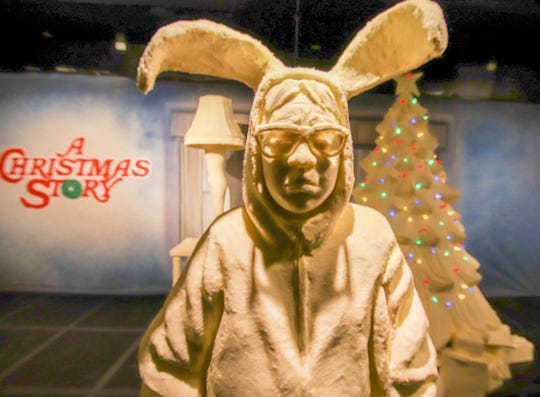 """This Monday, July 16, 2018, photo provided by the American Dairy Association Mideast shows Ohio State Fair butter sculpture depicting the character Ralphie in bunny suit pajamas from """"A Christmas Story"""" in the Dairy Products Building at The Ohio Expo Center & State Fair in Columbus, Ohio. This and other sculptures mark the 35th anniversary of the 1983 movie. The American Dairy Association Mideast says sculptors spent more than 400 hours creating the refrigerated display unveiled Tuesday, July 24, 2018, crafted from more than a ton of butter."""