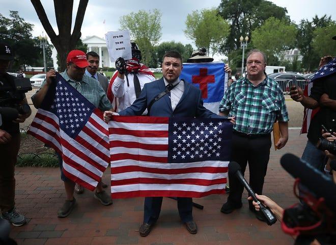 Unite the Right rally organizer Jason Kessler speaks in Lafayette Park across from the White House, Aug. 12, 2018, Washington, D.C.