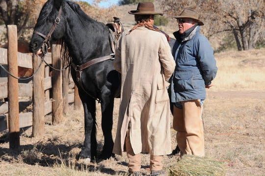 """Sled Reynolds talks with an unidentified person on the set of """"Yellowstone"""" where he and his team from Gentle Jungle are animal trainers for the TV series."""