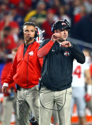 December 31, 2016; Glendale, AZ, USA;  Ohio State Buckeyes wide receivers coach Zach Smith (right) alongside head coach Urban Meyer against the Clemson Tigers in the the 2016 CFP semifinal at University of Phoenix Stadium. Mandatory Credit: Mark J. Rebilas-USA TODAY Sports