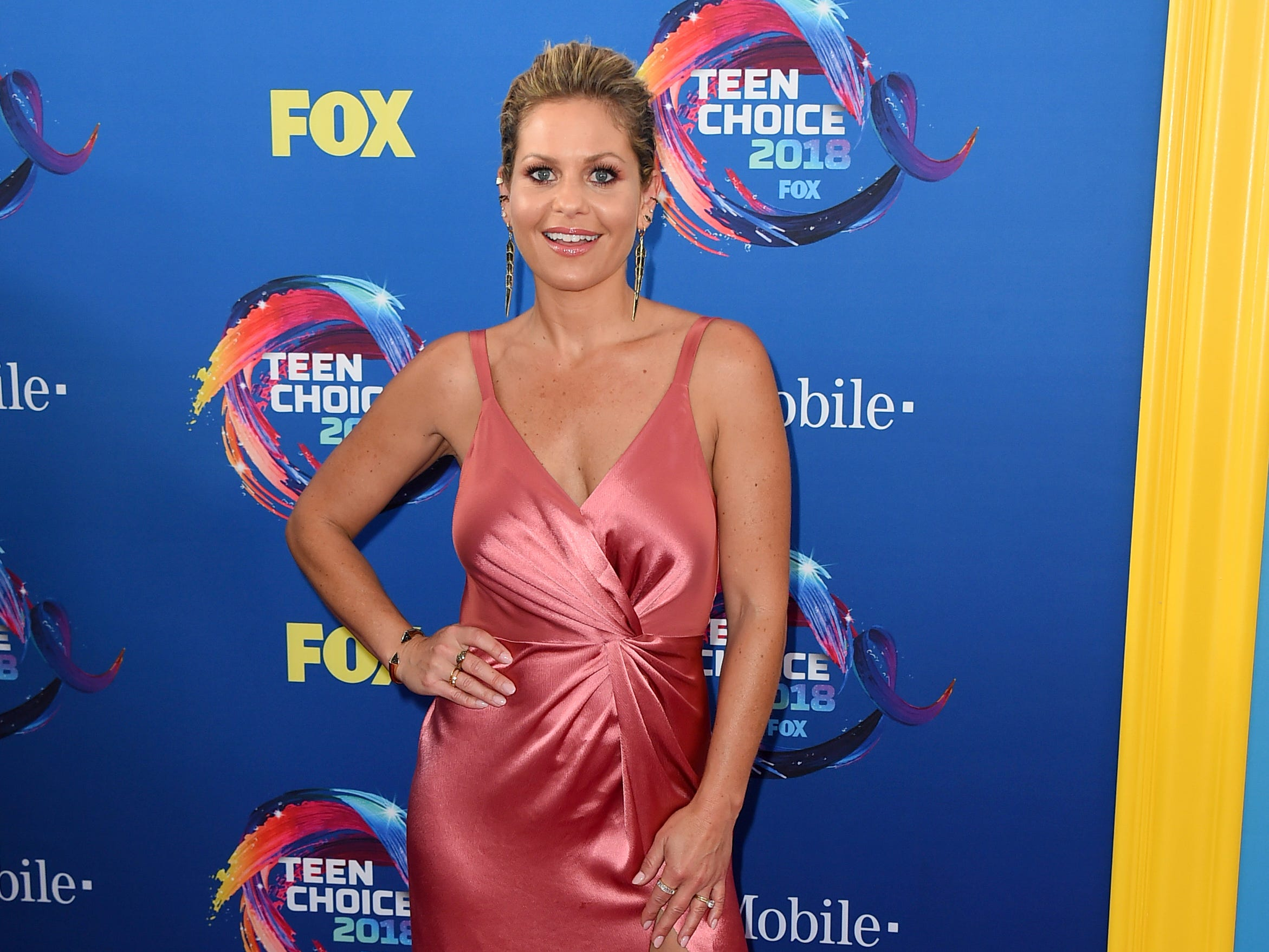 Candace Cameron-Bure arrives at the Teen Choice Awards at The Forum on Sunday, Aug. 12, 2018, in Inglewood, Calif. (Photo by Jordan Strauss/Invision/AP) ORG XMIT: CAPM141