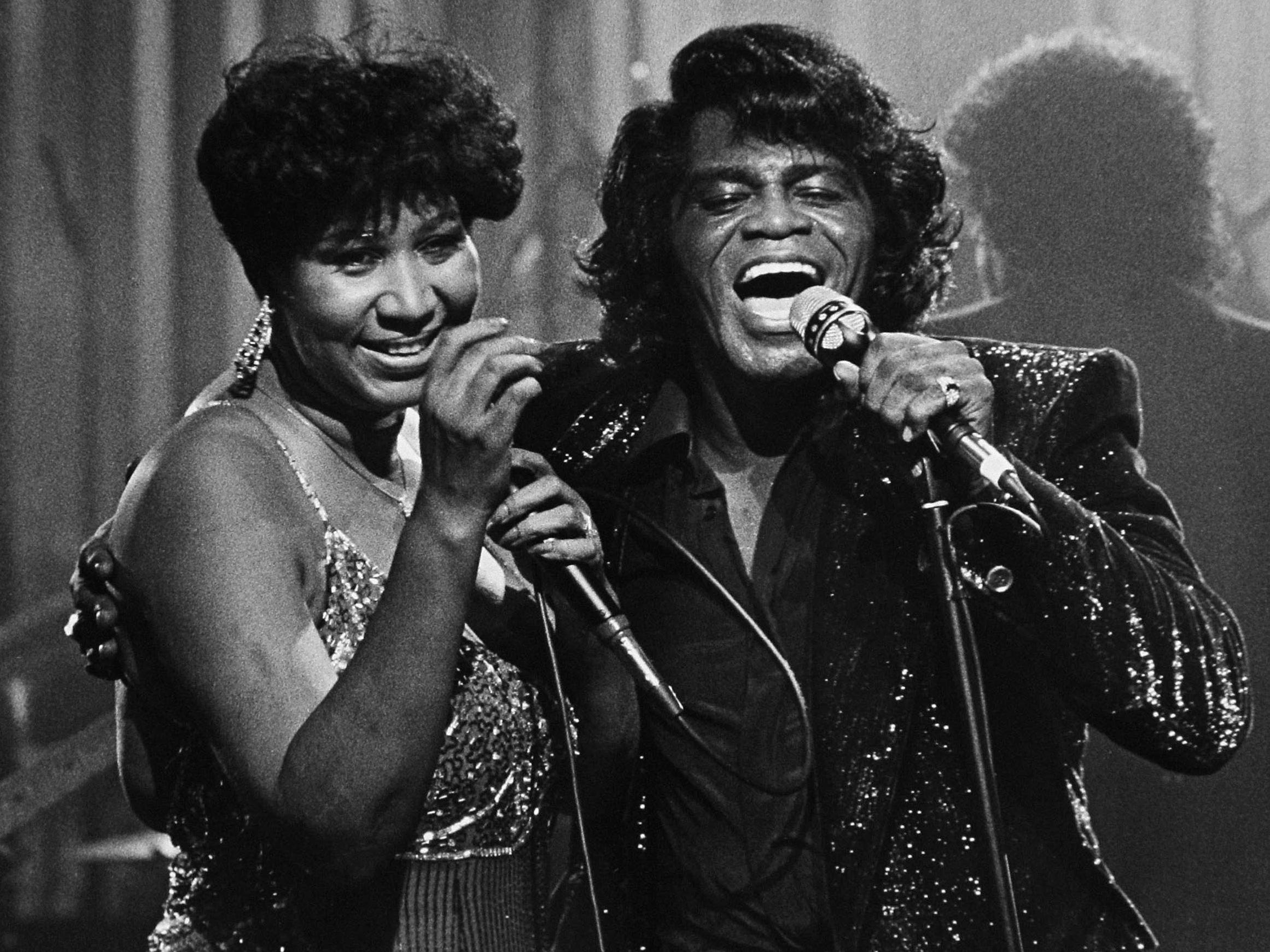 1ORG XMIT: MICO202 FILE - In this Jan. 11, 1987 file photo, soul singers James Brown and Aretha Franklin sing during a Home Box Office taping at the Taboo night club in Detroit. (AP Photo/Rob Kozloff, FILE)