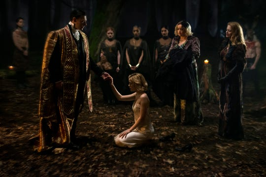 "Sabrina (Kiernan Shipka, center) takes part in a dark baptism in Netflix's ""Chilling Adventures of Sabrina."""