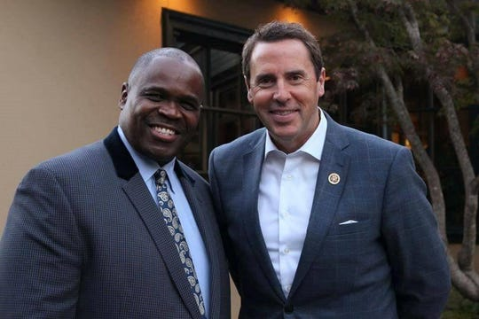 Rev. Odell Cleveland and Rep. Mark Walker are pictured.