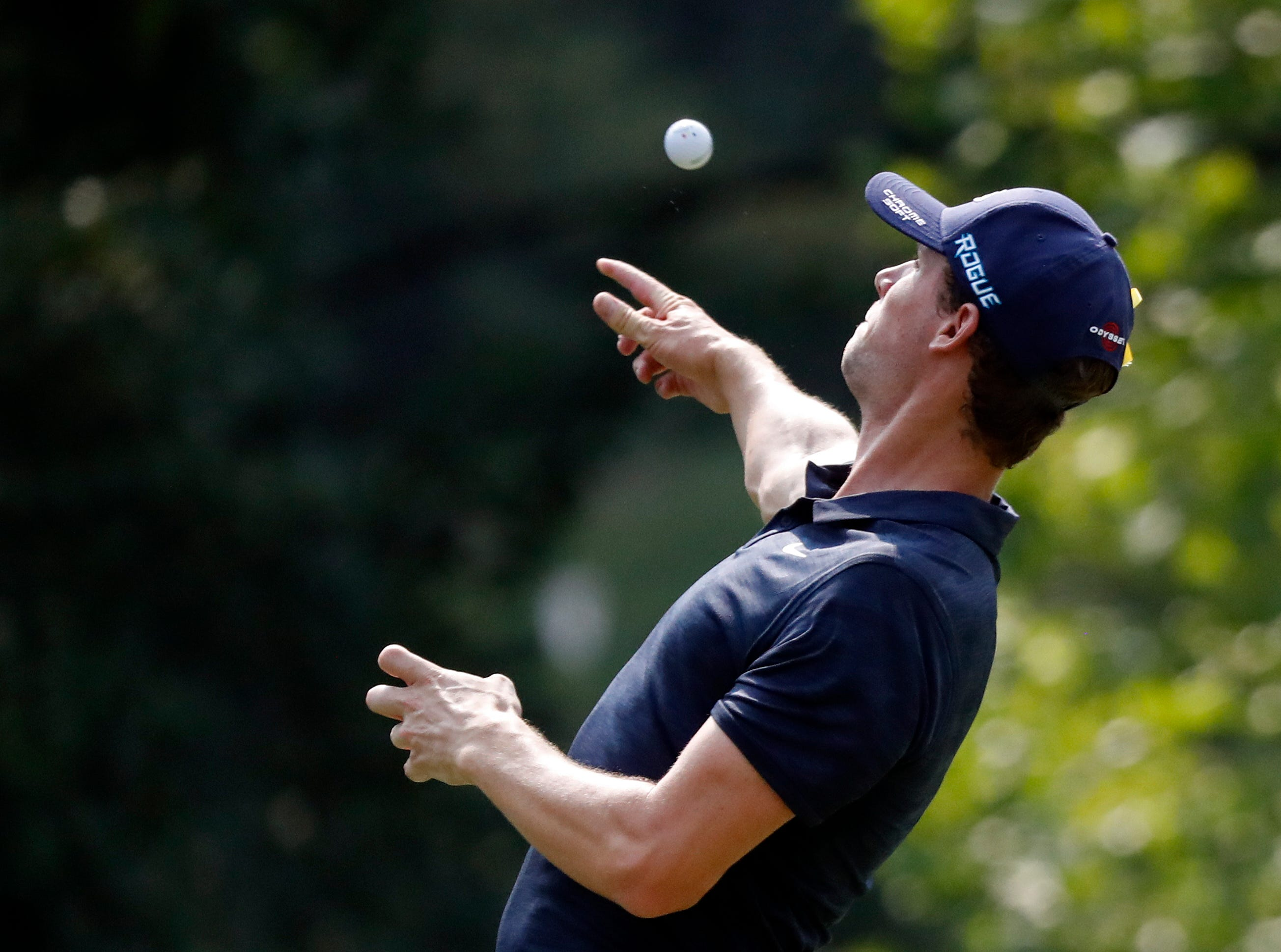 Thomas Pieters throws a ball after finishing the 17th hole.