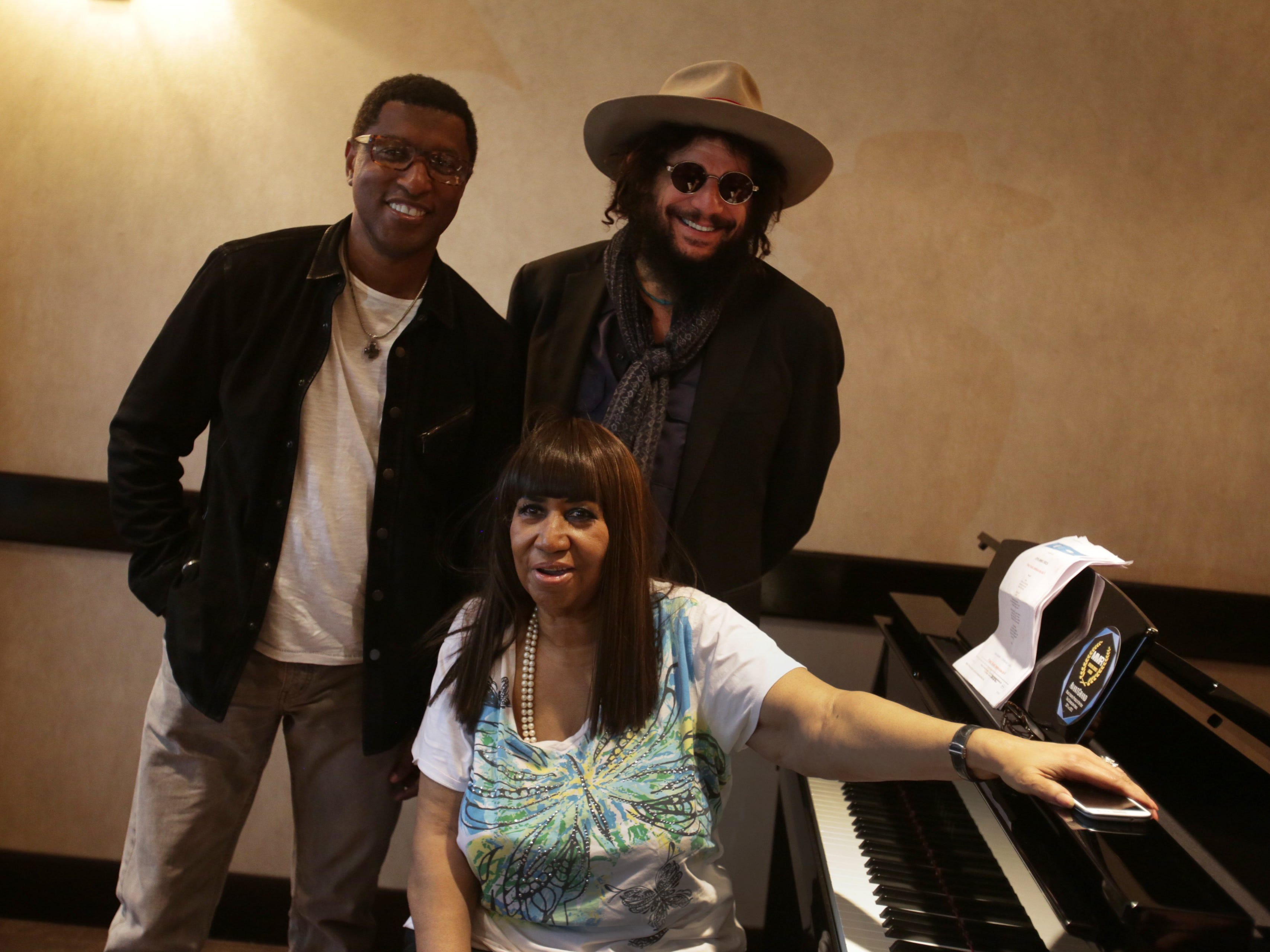 Aretha Franklin poses for a photograph with veteran producer Don Was, right and longtime friend and producer Kenny (Babyface) Edmonds during their first pre production meeting for her upcoming album at the Westin hotel in Southfield, MI on Thursday October 17, 2013.