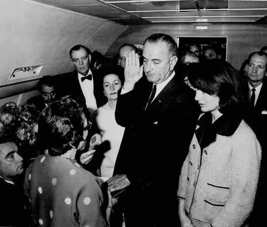 On Nov. 22, 1963, with Jacqueline Kennedy looking on, Lyndon B. Johnson is sworn in as president aboard Air Force One. It was 2:38 p.m. Dallas time, 22 minutes after John Kennedy's body was loaded onto the plane, according to a timeline by the Sixth Floor Museum. In nine minutes the plane will take off for Andrews Air Force base.