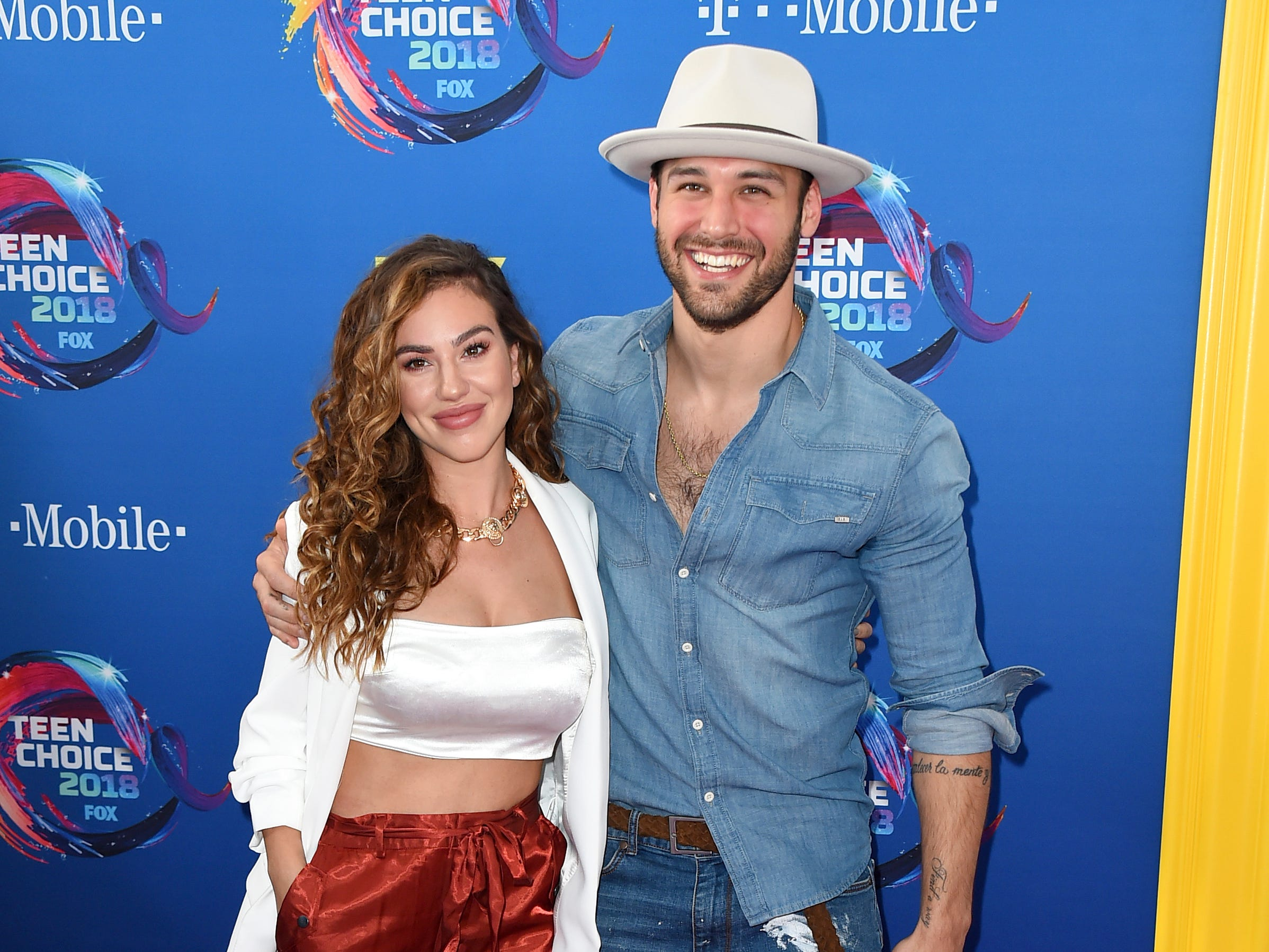 Chrysti Ane, left, and Ryan Guzman arrive at the Teen Choice Awards at The Forum on Sunday, Aug. 12, 2018, in Inglewood, Calif. (Photo by Jordan Strauss/Invision/AP) ORG XMIT: CAPM137