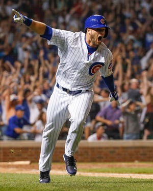 Chicago Cubs third baseman David Bote (13) reacts after hitting game winning grand slam against the Washington Nationals at Wrigley Field.