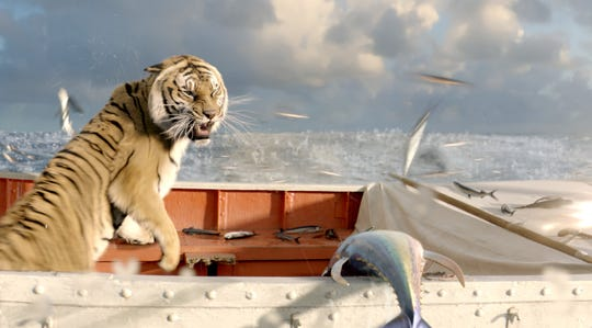 "In scenes from the ""Life of Pi"" movie where a real tiger was used, the tiger was trained by animal wrangler Sled Reynolds."