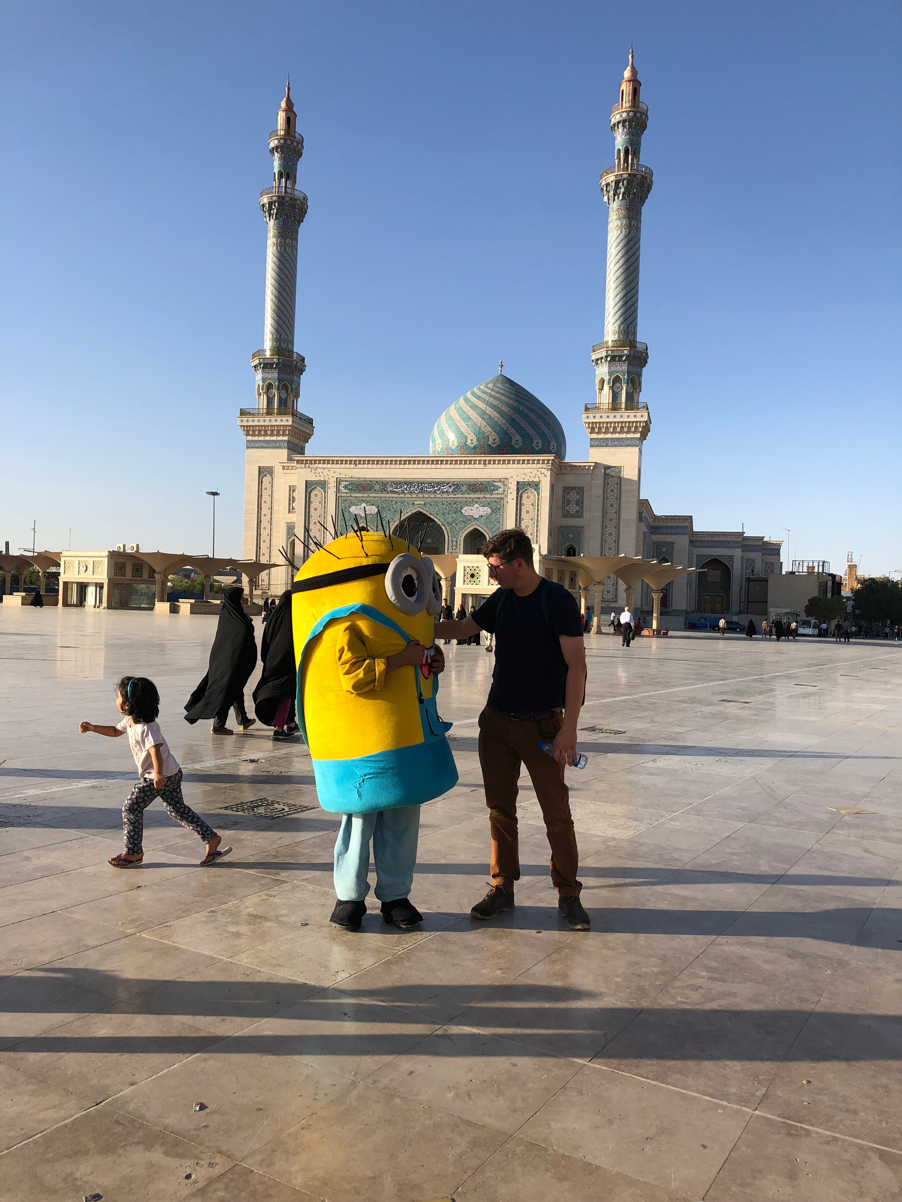 USA TODAY reporter Kim Hjelmgaard greets a child dressed in a Minion costume from the 2015 animated comedy film, in Qom, Iran, on July 12, 2018.