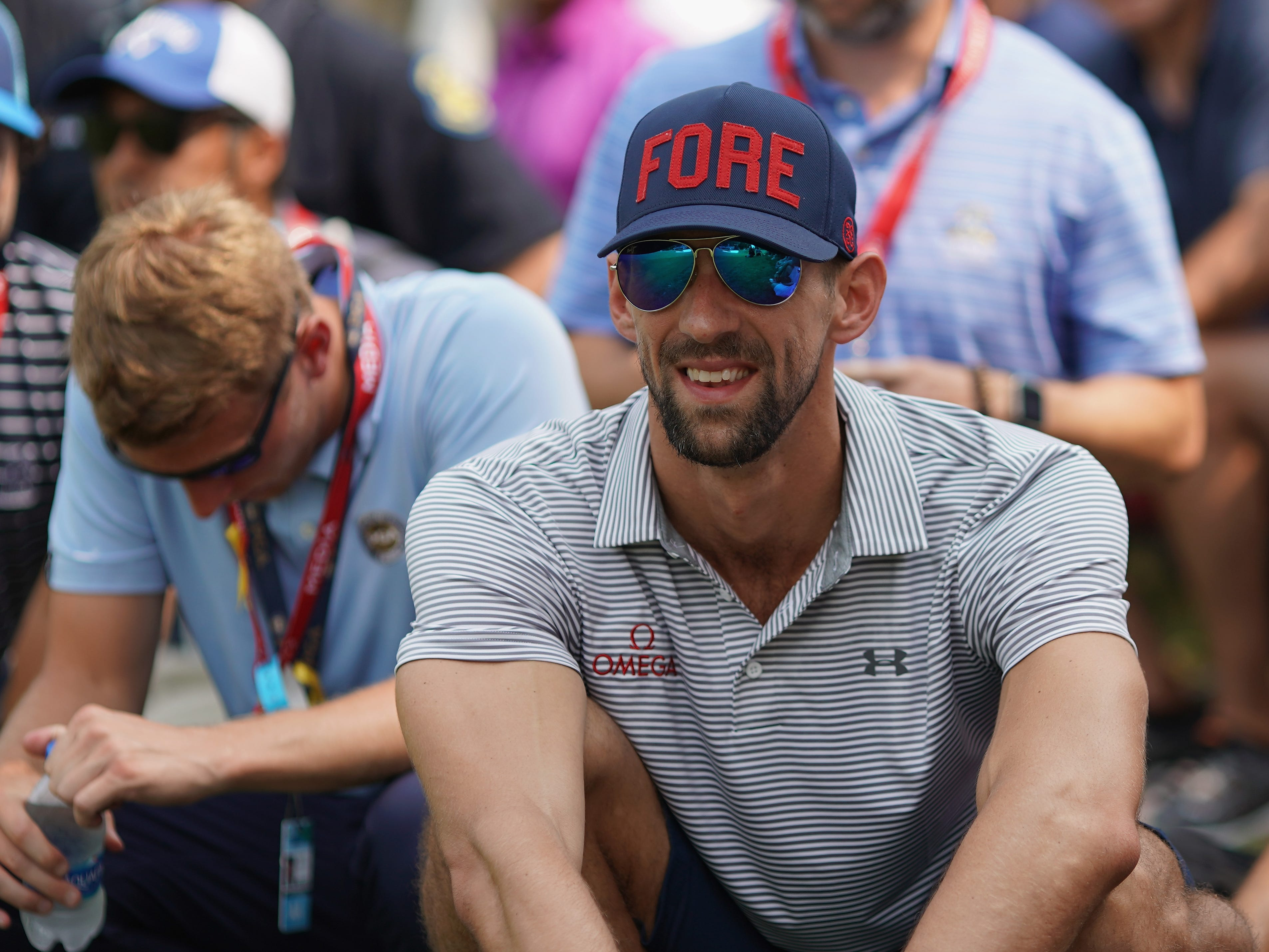 Former Olympic swimmer Michael Phelps attends the final round of the PGA Championship.