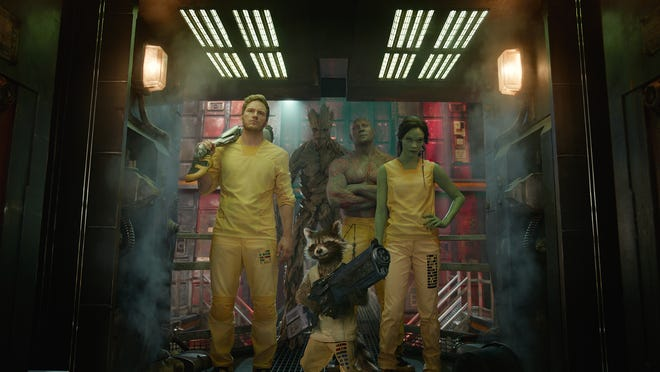 """Star-Lord (Chris Pratt, from left), Groot (voiced by Vin Diesel), Rocket Racoon (voiced by Bradley Cooper), Drax (Dave Bautista) and Gamora (Zoe Saldana) play the misfit heroes of """"Guardians of the Galaxy."""""""