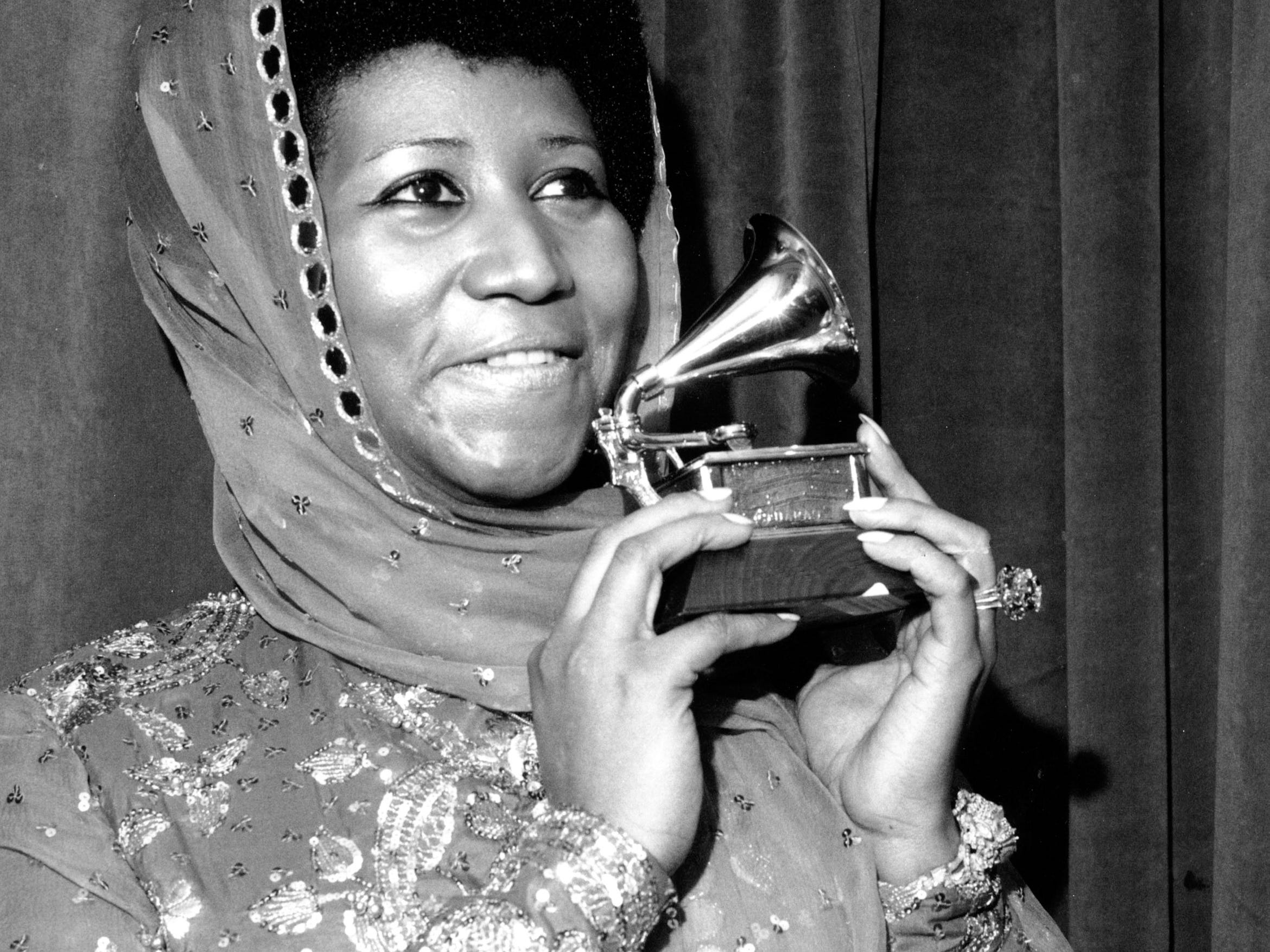 "Singer Aretha Franklin poses with her Grammy Award at the 17th Annual Grammy Award presentation in New York on March 3, 1975. The award is for her performance in ""Ain't Nothing Like the Real Thing."" Franklin has won every Grammy Award for ""Best Rhythm and Blues Performance, Female"" since this category was created in 1968. (AP Photo)"