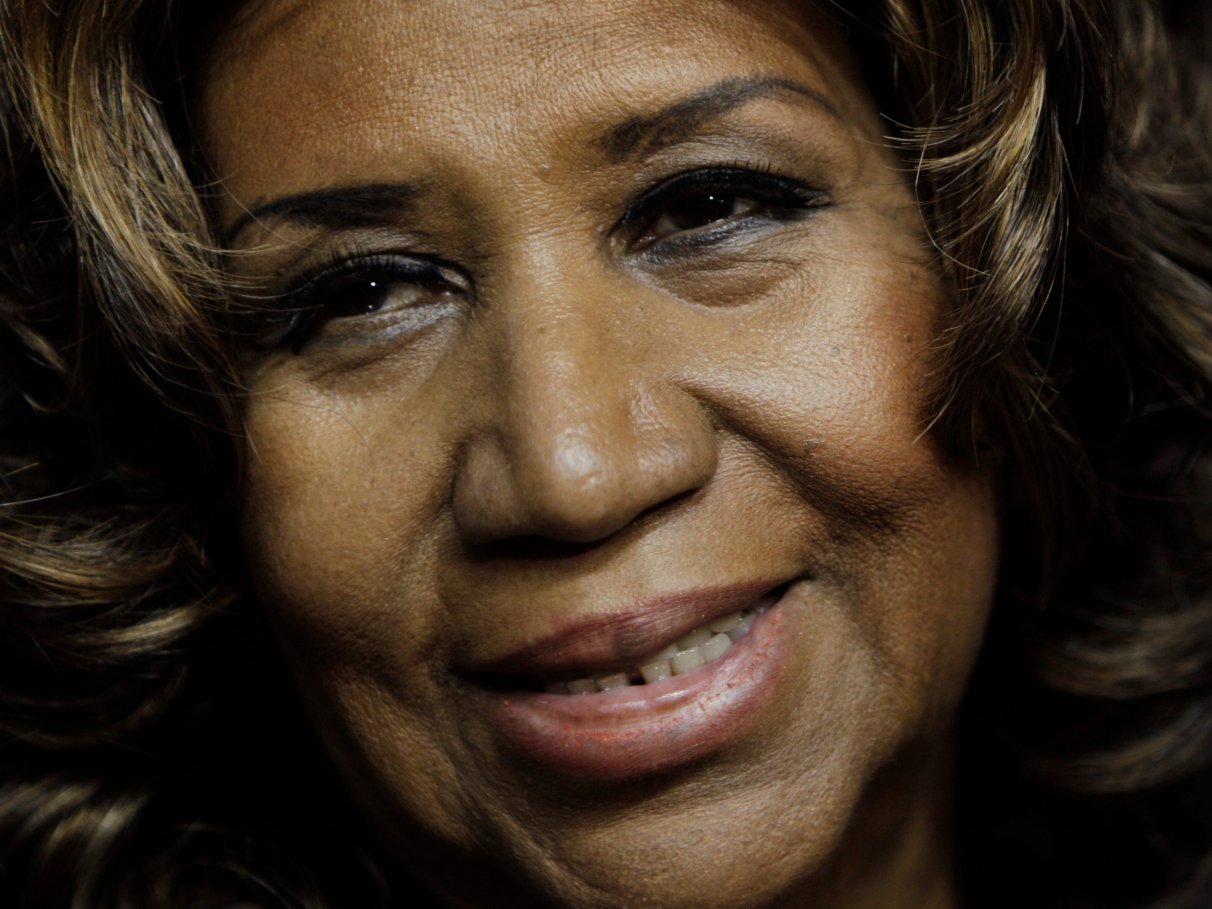 "ORG XMIT: NY115 FILE - In this Feb. 11, 2011 file photo, Aretha Franklin smiles after the Detroit Pistons-Miami Heat NBA basketball game in Auburn Hills, Mich. Franklin, who says she's back at ""150 percent,"" is planning to return to the stage in May for her first post-surgery performance. (AP Photo/Paul Sancya)"