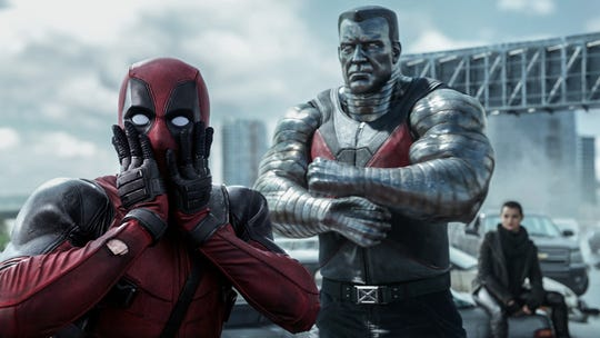 The title masked mercenary (Ryan Reynolds) and his metallic buddy Colossus (voiced by Stefan Kapicic) in 'Deadpool.'
