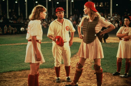 Abbi Jacobson is working on a TV version of the 1992 film, 'A League of Their Own,' which featured Lori Petty, left, Tom Hanks and Geena Davis.