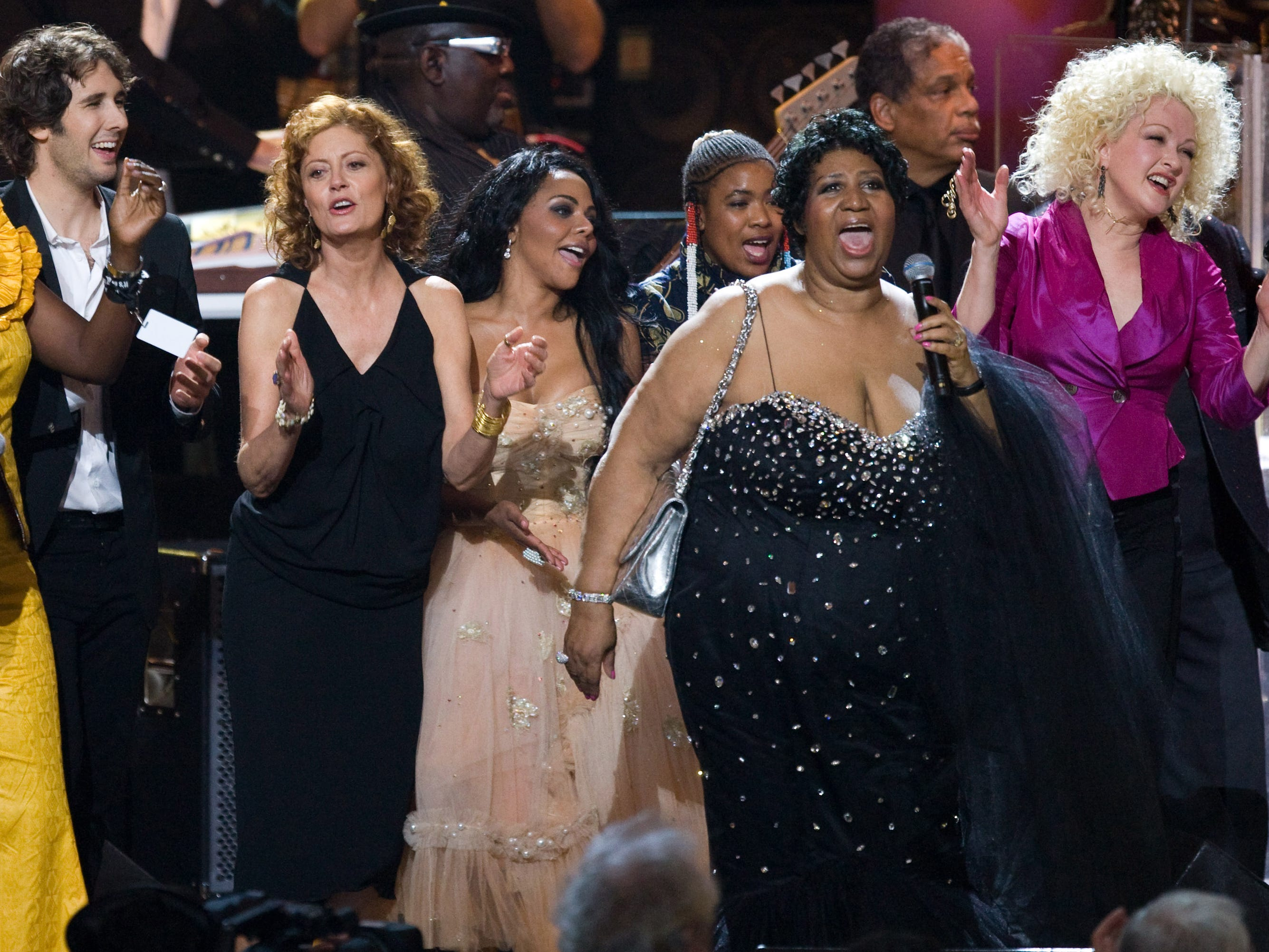 Josh Groban, Susan Sarandon, Little Kim, Aretha Franklin and Cyndi Lauper gather on stage for the finale of the  'Mandela Day' Concert to celebrate Nelson Mandela's 91st birthday at Radio City Music Hall in New York, Saturday, July 18, 2009. (AP Photo/Charles Sykes) ORG XMIT: NYCS710