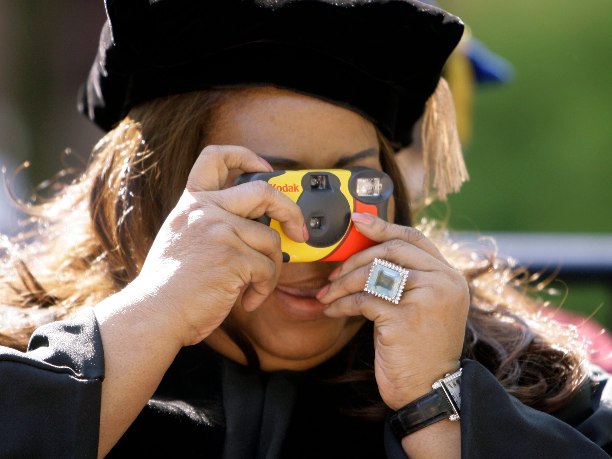 Performer Aretha Franklin snaps a photo of an academic procession before the University of Pennsylvania Commencement ceremony in Philadelphia, Monday, May 14, 2007. Franklin received honorary degree during the ceremony. (AP Photo/Matt Rourke)  ORG XMIT: PAMR107