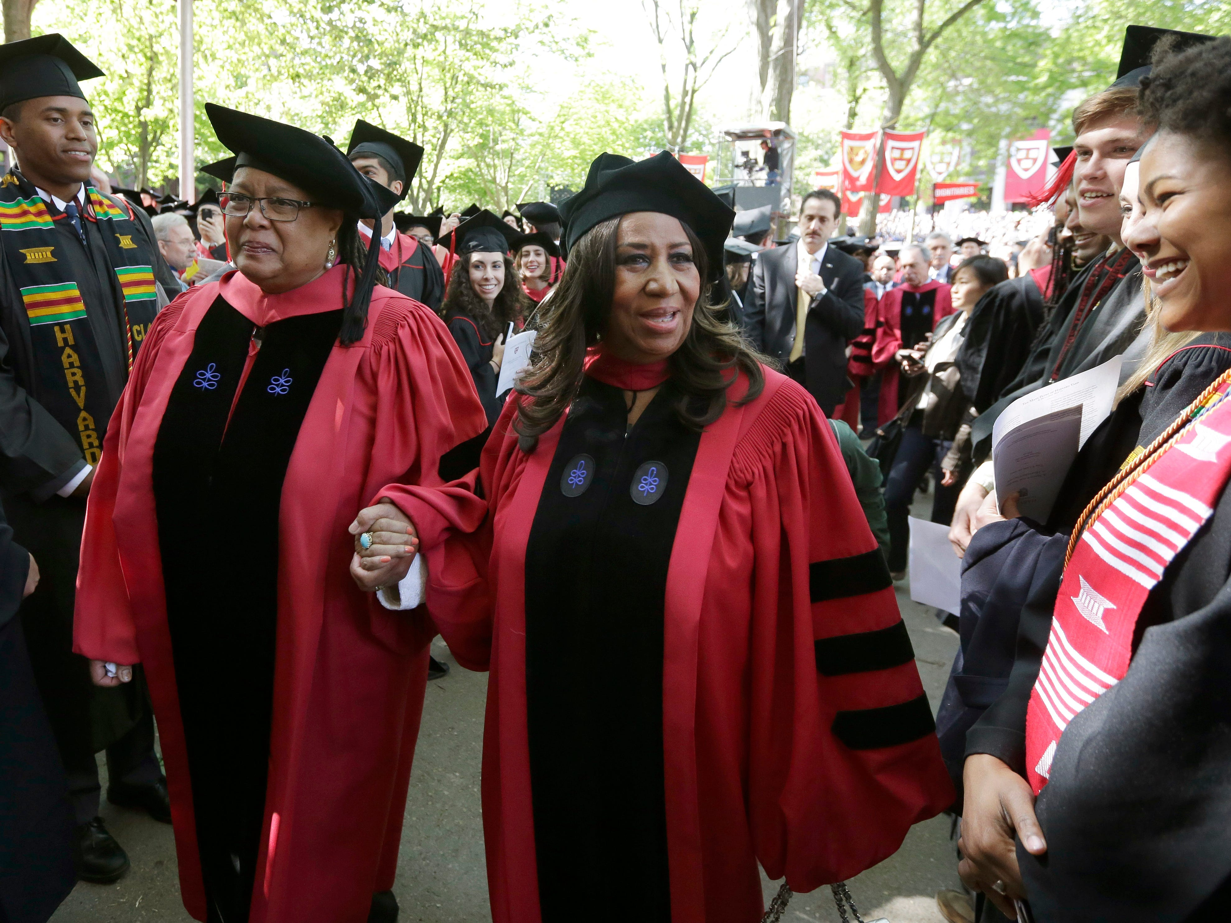Singer Aretha Franklin, center, walks in a procession during Harvard University commencement ceremonies, Thursday, May 29, 2014, in Cambridge, Mass. Franklin was presented with an honorary Doctor of Arts degree during the ceremony. (AP Photo/Steven Senne) ORG XMIT: o3