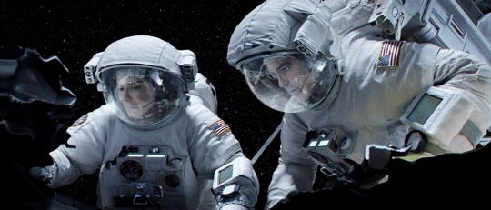 "Sandra Bullock and George Clooney are astronauts in ""Gravity."""