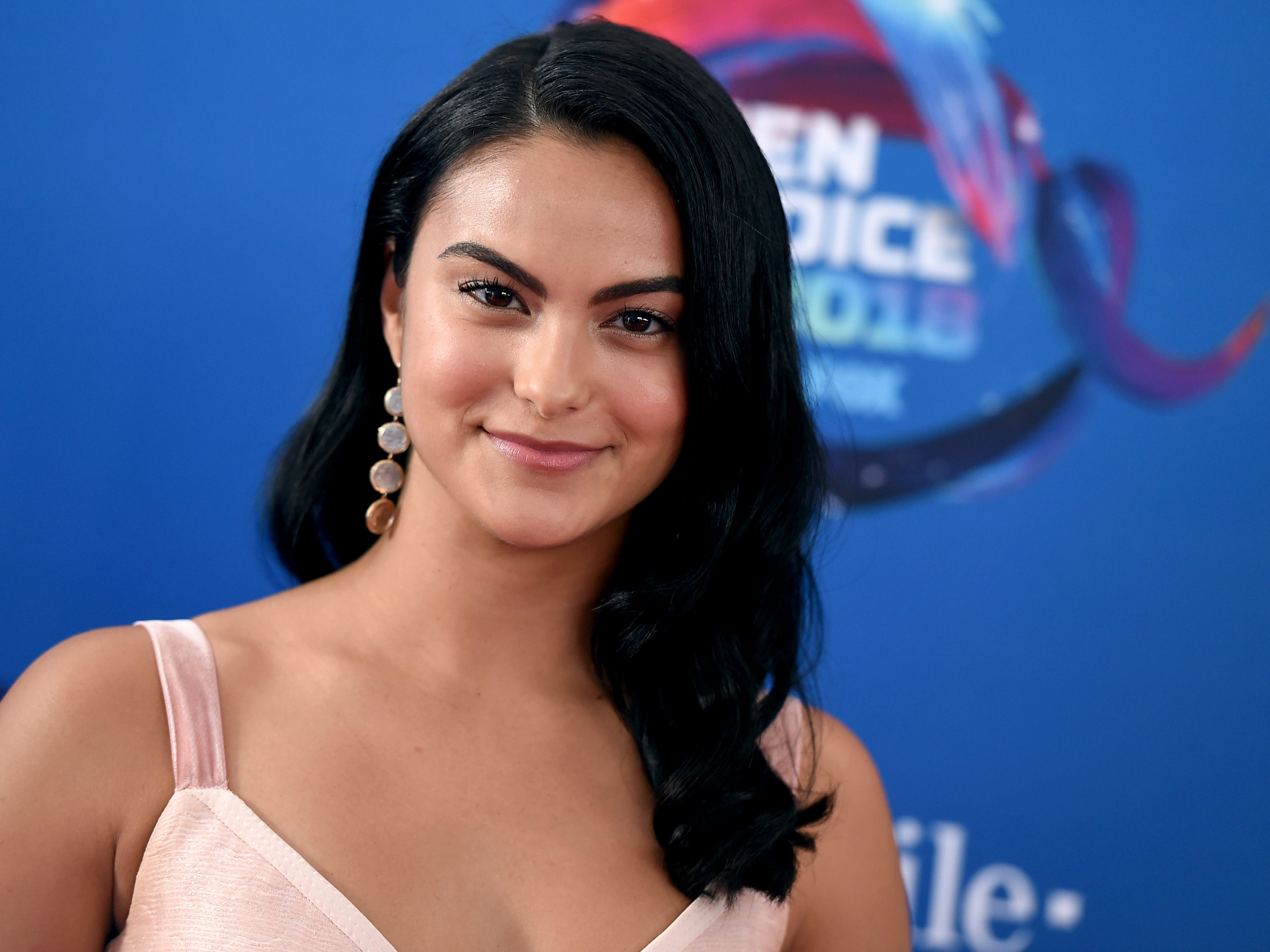 Camila Mendes arrives at the Teen Choice Awards at The Forum on Sunday, Aug. 12, 2018, in Inglewood, Calif. (Photo by Jordan Strauss/Invision/AP) ORG XMIT: CAPM162