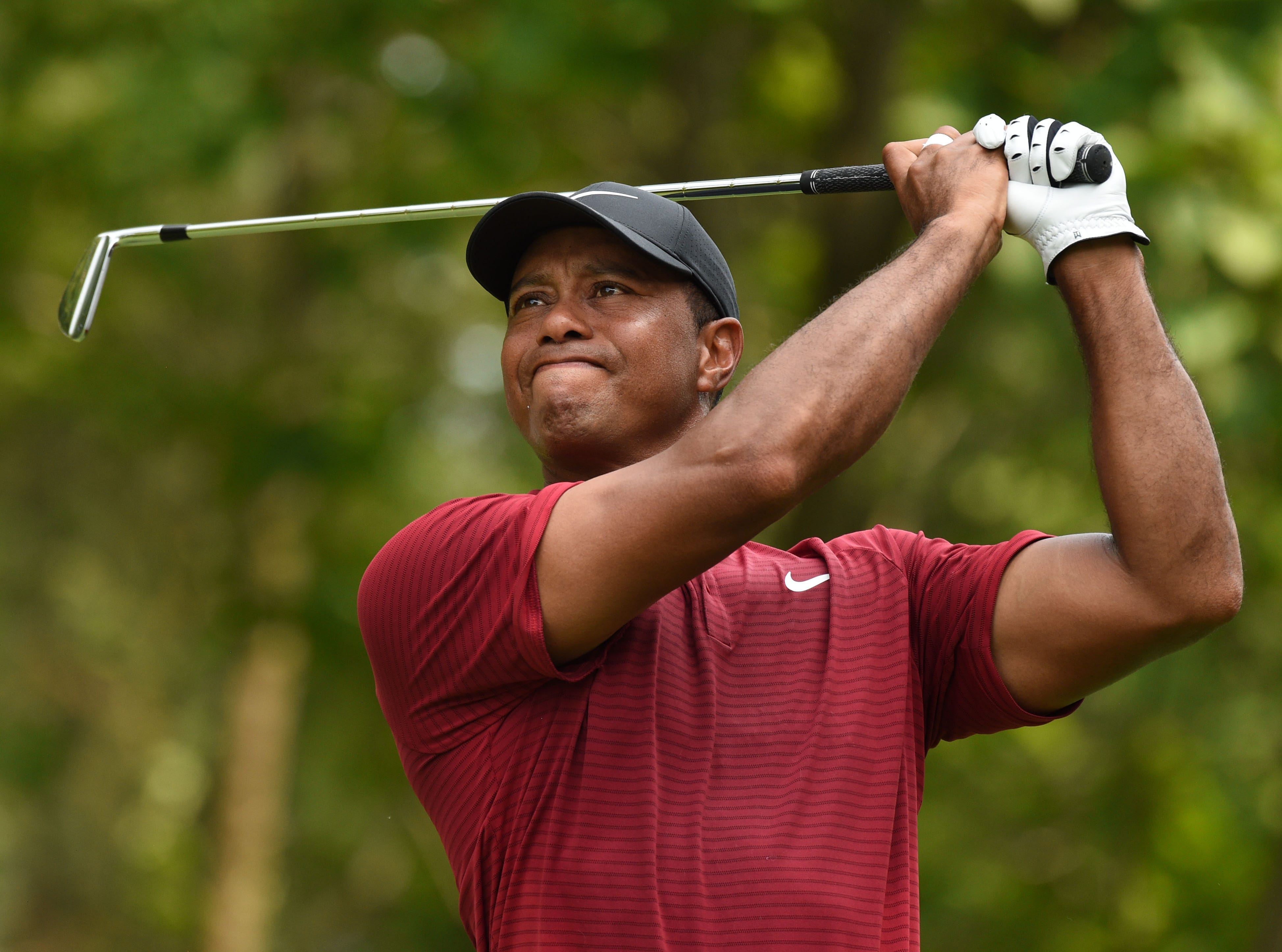 Tiger Woods hits his tee shot on the 11th hole during the final round.