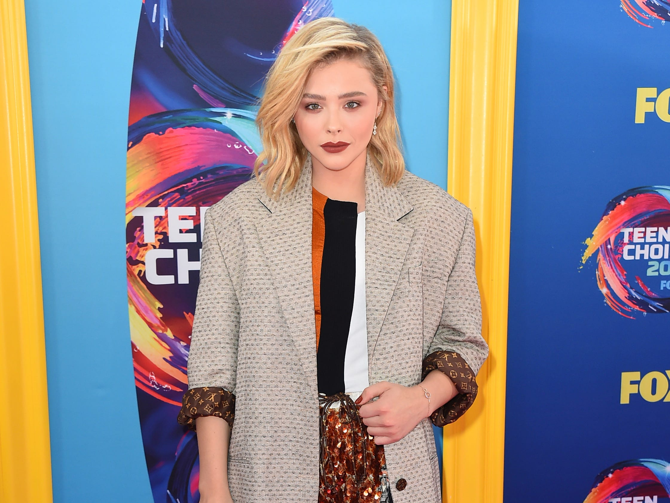 Chloe Grace Moretz arrives at the Teen Choice Awards at The Forum on Sunday, Aug. 12, 2018, in Inglewood, Calif. (Photo by Jordan Strauss/Invision/AP) ORG XMIT: CAPM142