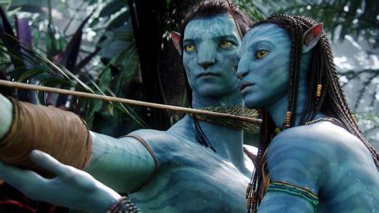 "Jake Sully (Sam Worthington) and Neytiri (Zoe Saldana) are heroes on a wondrous alien world in ""Avatar."""