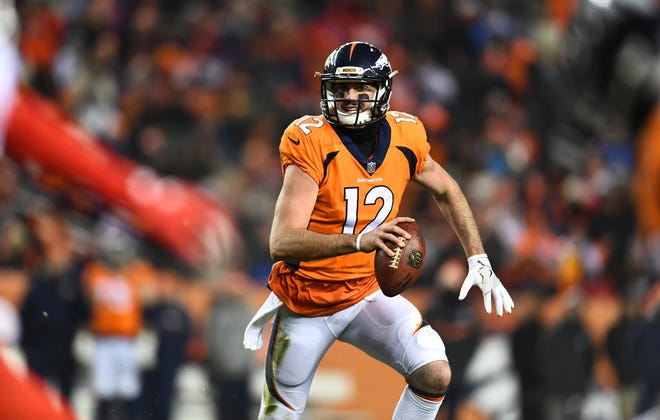 Denver Broncos quarterback Paxton Lynch (12) scrambles in the fourth quarter against the Kansas City Chiefs at Sports Authority Field at Mile High.