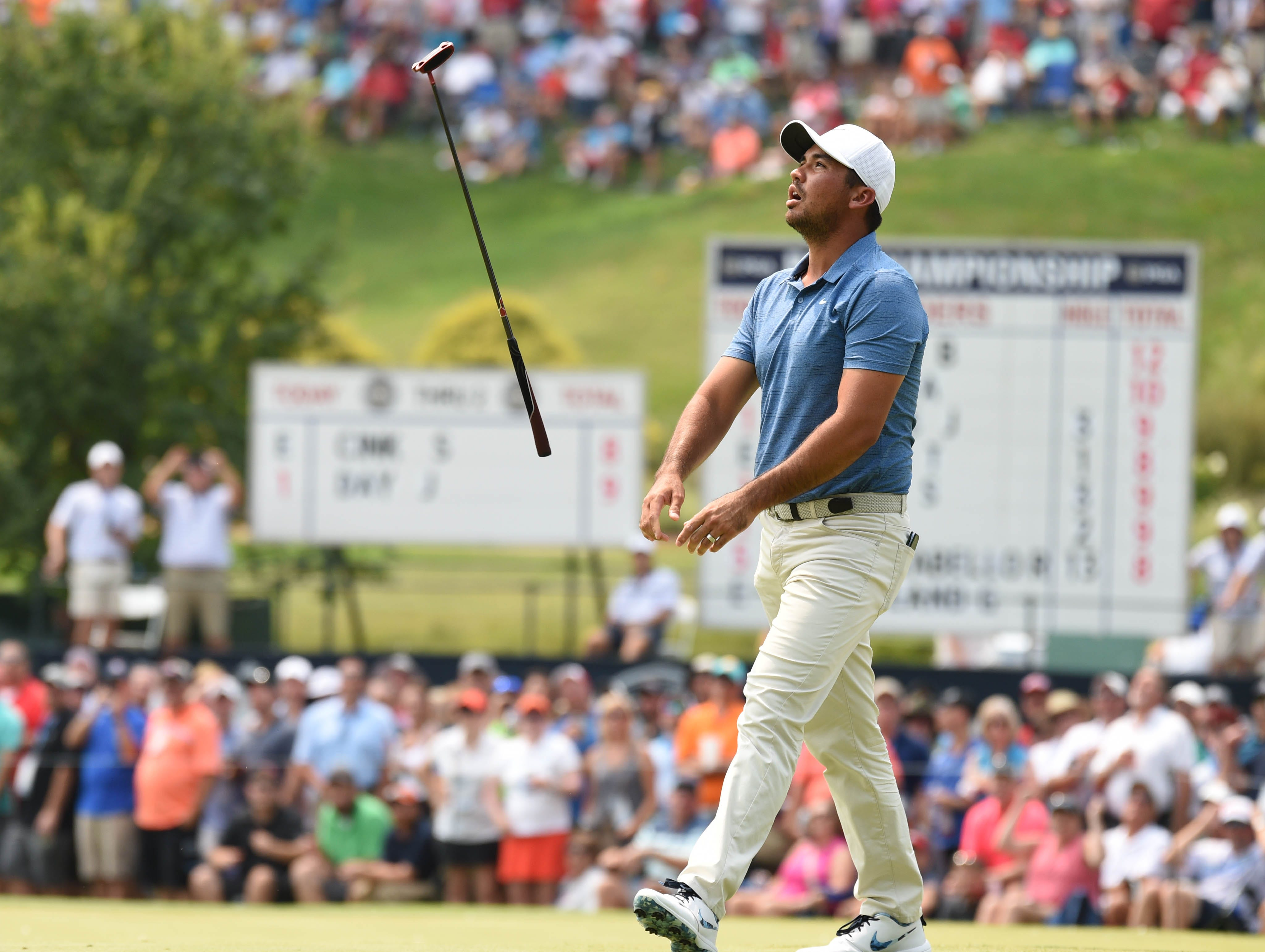 Jason Day reacts after missing a putt on the third green during the final round.