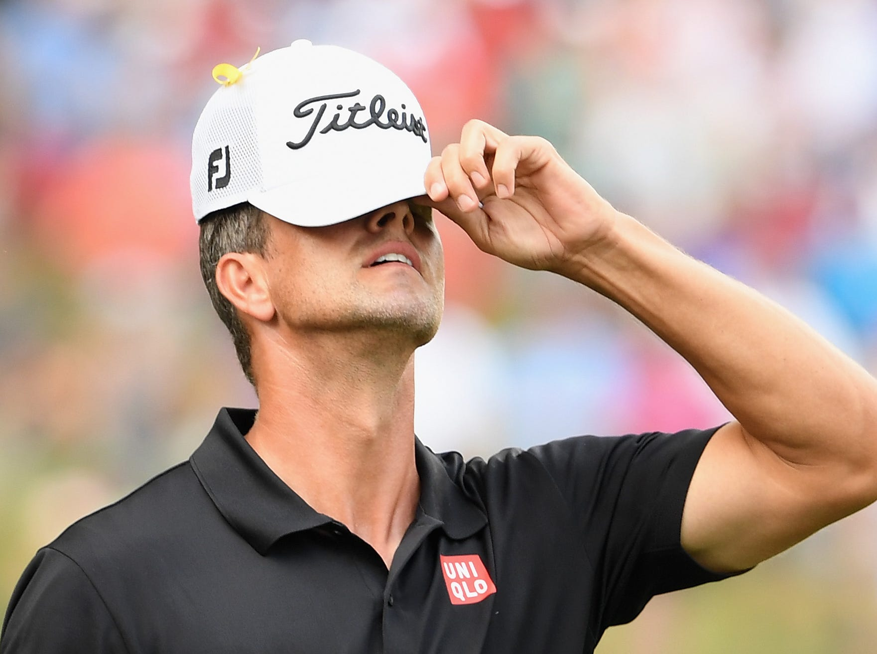 Adam Scott reacts on the 16th hole during the final round.