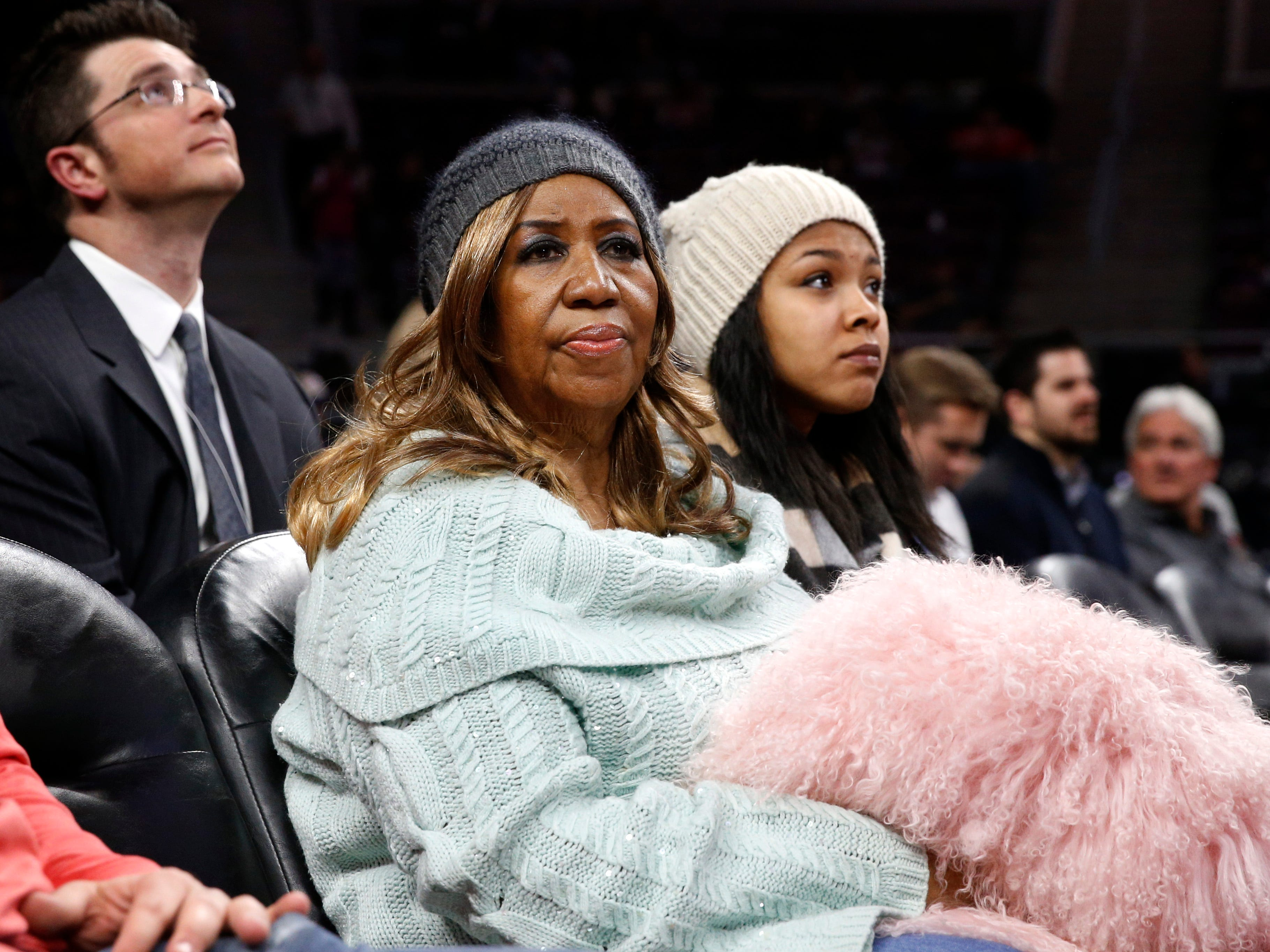 Aretha Franklin watches during an NBA basketball game between the San Antonio Spurs and Detroit Pistons in Auburn Hills, Mich., Wednesday, Feb. 11, 2015. (AP Photo/Paul Sancya) ORG XMIT: MIPS115