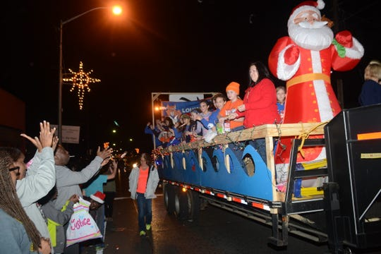 The 2014 Pineville Christmas Parade makes its way down Main Street. City officials would like to utilize the downtown street more for events.