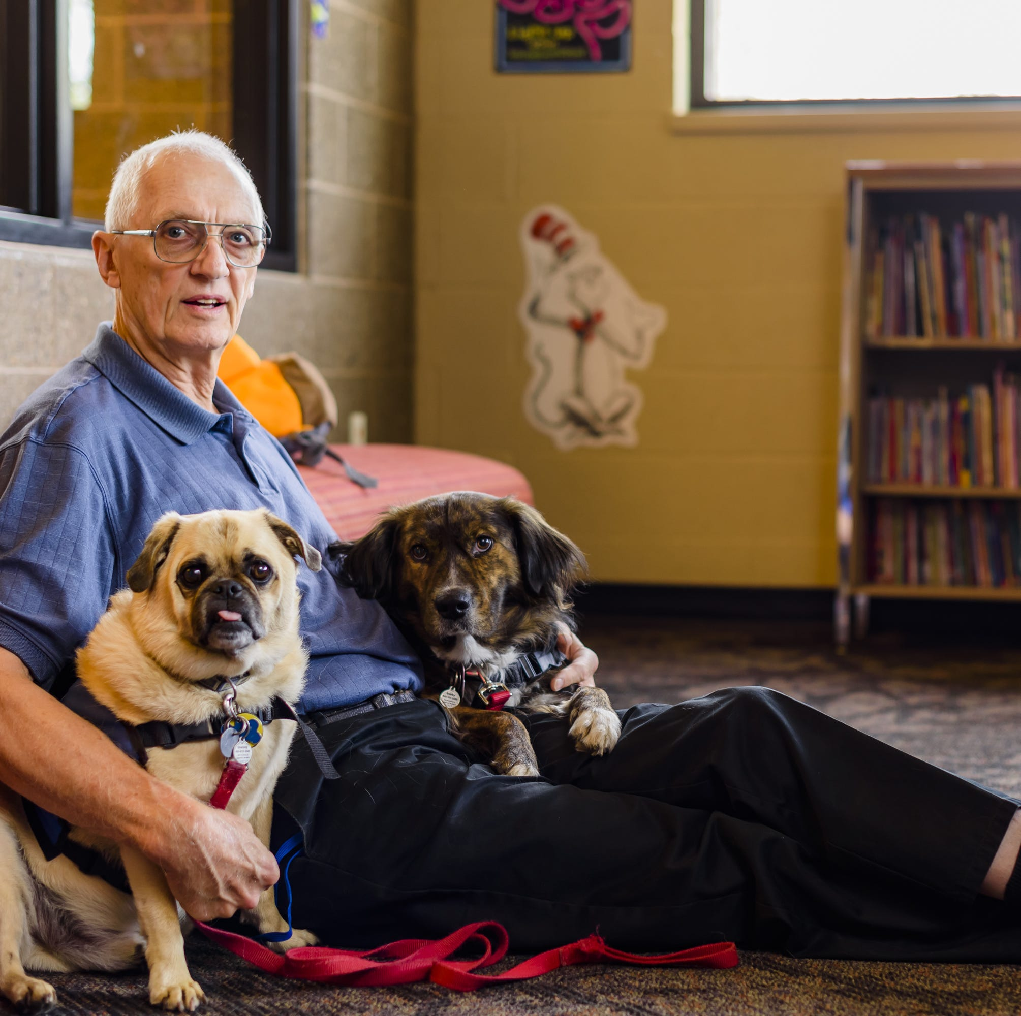 Working with therapy dogs and kids is rewarding for Appleton man