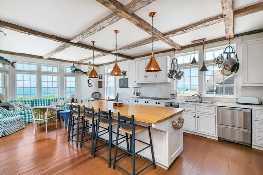 The kitchen features an oversized center island and custom cabinetry.