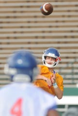 Cooper quarterback Henry Ferrel, right, throws a pass to Nyjil Williams during the first day of fall practice Monday, Aug. 13, 2018 at Shotwell Stadium.