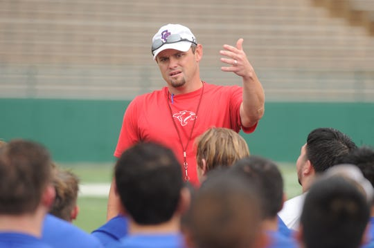 First-year Cooper coach Aaron Roan talks to his team after the first day of fall practice Monday, Aug. 13, 2018 at Shotwell Stadium.