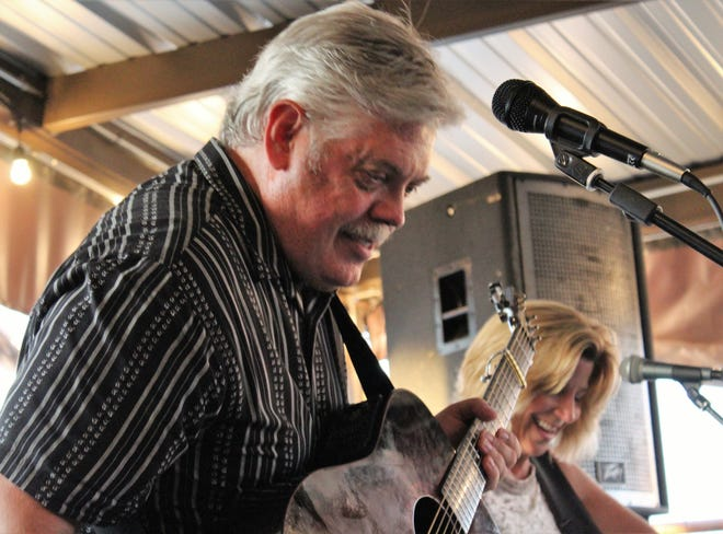 Lloyd Maines and Terri Hendricks fulfilled their promise to perform uplifting songs at Friday's patio concert for the Taylor County Child Welfare Board at Lytle Land & Cattle Co. restaurant.