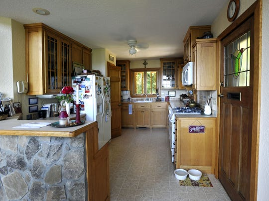 The kitchen is the smallest room in the Brookers' house but perfectly sized for two people.